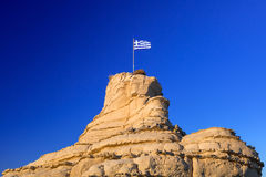 Greek flag on the rock Royalty Free Stock Photos