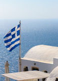 Greek flag on roof of Santorini house Stock Images