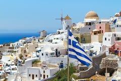 Greek flag on Santorini island. Oia village scenery with Greek flag on Santorini island Stock Photos