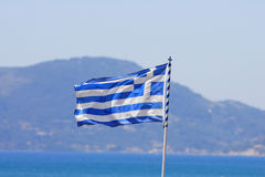 Greek flag by the sea Royalty Free Stock Image