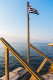 Greek flag and sea Stock Photography
