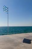 Greek flag and shadow on promenade in Paleo Faliro, Athens Stock Photography