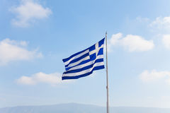 Greek flag with sky in Athens, Greece Stock Photography