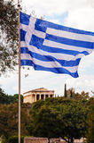 Greek flag and Temple of Hephaestus in Athens, Greece Stock Image