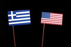 Greek flag with USA flag isolated on black. Background royalty free stock images
