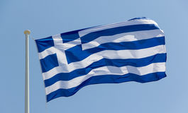 Greek flag waving. Photo of a Greek flag waving against blue sky stock image