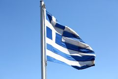Greek flag. Waving on blue sky royalty free stock image