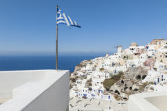 Greek Flag waving in Oia Santorini Stock Images