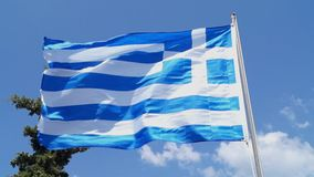 Greek flag waving over blue background. Strong wind stock video