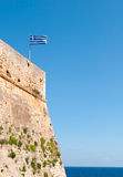 Greek flag waving  on  Rethymno  city castle in Crete, Greece Royalty Free Stock Photo