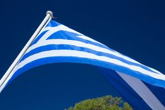The Greek flag on a pole Royalty Free Stock Photography
