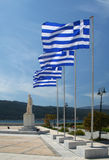 Greek Flags on Flagpoles waving with blue sky Royalty Free Stock Photos