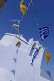 Greek flags flying on church Royalty Free Stock Photo