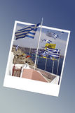Greek flags in Santorini, instant photo frame Royalty Free Stock Image