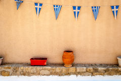 Greek flags on wall with poteries - Hraion Stock Photography