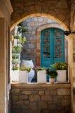 Greek flowerpots with flowers Stock Image