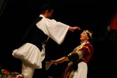 Greek folk dancers isolated on black Stock Images