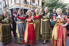Greek folklore group. THESSALONIKI, GREECE - OCT 14:Greek folklore dancers - street parade during the event of celebrating 100 years since the liberation of Stock Photography