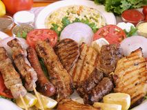 Greek food. A platter of various delicious grilled Greek meat stock images