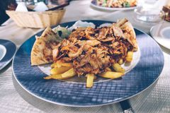 Greek food, chicken and pork mixed gyros on plate royalty free stock photos