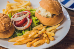 Greek food concept. Bun with chicken salad, french fries royalty free stock photos