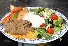 Greek Food Menu item lamb salad peppers olives Stock Image