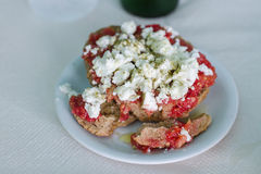 Greek food rusk with tomato and feta cheese Stock Photos