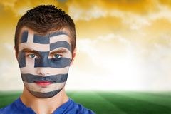 Greek football fan in face paint Royalty Free Stock Photo