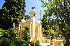 Greek gazebo in the arboretum in Sochi, Russia, summer day. Shady alley in the arboretum of Sochi, Russia, summer day Royalty Free Stock Image