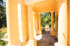 Greek gazebo in the arboretum in Sochi, Russia, summer day. Shady alley in the arboretum of Sochi, Russia, summer day Stock Images