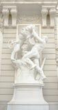 Greek god wrestling a lion Stock Images