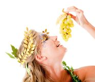 Greek goddess eating grapes Royalty Free Stock Images