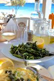 Greek greens, salad with leaf vegetables and greek Fava near the sea - Dodecanese Islands. Greens or Khorta is common side dish and usually seasoned with olive royalty free stock photography
