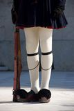 Greek guardsman with rifle from waist down Stock Image