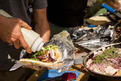 Greek gyro. Cooking Greek gyros at the Farmers Market Royalty Free Stock Photography