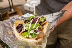 Greek gyro. Cooking Greek gyros at the Farmers Market Stock Photos