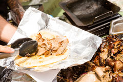 Greek gyro. Cooking Greek gyros at the Farmers Market Royalty Free Stock Photo
