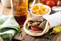 Greek gyro pita wrap. With curly fries Stock Photography