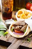 Greek gyro pita wrap. With curly fries Royalty Free Stock Photos