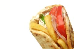 Greek gyros kebab. Traditional greek food gyros kebab detail with copy space isolated on white background Royalty Free Stock Image