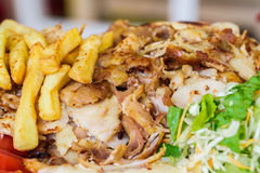 Greek gyros, meat, fried potatoes, tomatoes and onions stock images
