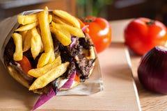 Greek Gyros pita with fresh salad ingredients. Gyros made in Greece in pita bread with fresh salad ingredients and tzatziki souce stock images