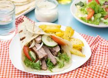 Greek gyros with pork, vegetables and homemade pita bread Stock Photography