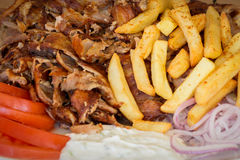Greek gyros, souvlaki,meat, fried potatoes, tomatoes and onions, Athens Greece, national food, traditional Greek cuisine Royalty Free Stock Photography