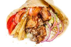 Greek gyros. Stuffed with meat, salad, onion, tomato and potato Stock Photography