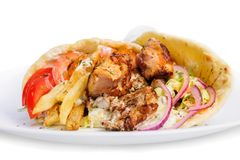Greek gyros. Stuffed with meat, salad, onion, tomato and potato Royalty Free Stock Photography