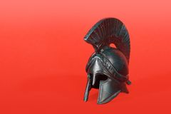 Greek helmet. Classical ancient greek helmet of cooper on red background Royalty Free Stock Photography