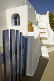Greek House. The gate of a greek house in Santorini, Greece with steps in the background against a clear blue sky Royalty Free Stock Photography