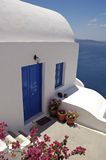 Greek house. And yard with meditterranean sea in the background Stock Photo