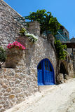 Greek House with Blue Door and Flowers Stock Photos